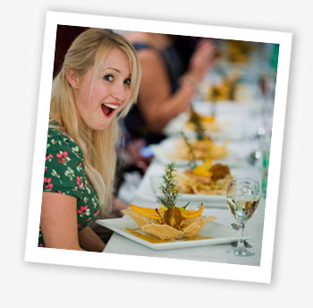 Dining club member Victoria Symon receives her chicken in a basket. © Isle of Wight wedding photographer Chris Cowley