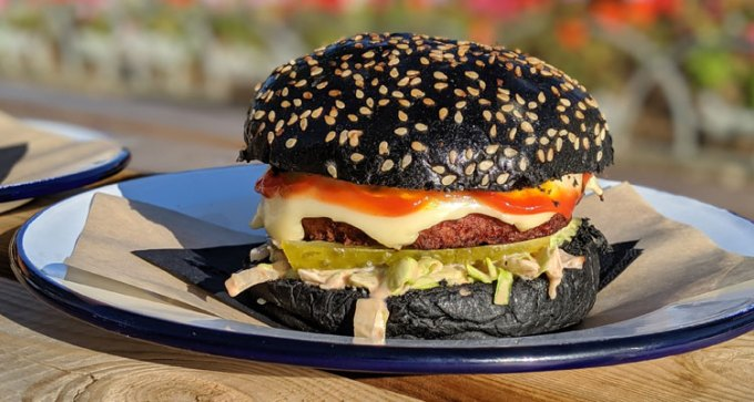 Plant-based burger in charcoal bun