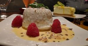 Poached meringue with raspberries
