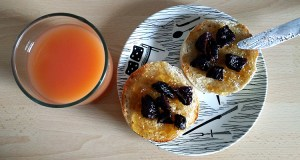 Ginger preserve with prunes on muffin