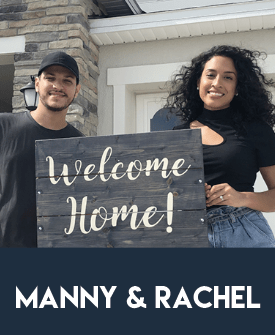 """Photo of clients Manny and Rachel standing in front of the home they just bought holding a """"Welcome Home!"""" sign."""