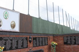 High walls separate the Falls from the Shankill. This is part of a memorial to republicans killed while making bombs in the houses destroyed where this memorial now stands.