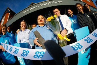 Luke Arnold and staff officially open the store. Co-Op Food re-opening,