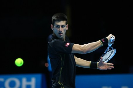 Novak Djokovic focused on the shot.