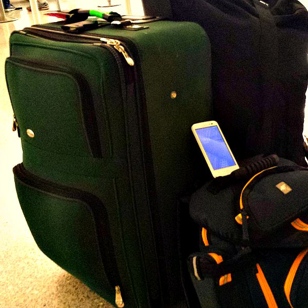 Luggage and phone at the airport #Tips4Trips