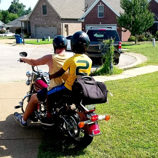 weldu-and-uncle-don-leaving-on-a-motorcycle