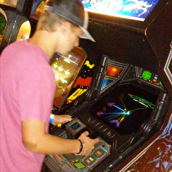Aiden playing the Star Wars arcade game at Boss Battle Games in Indianapolis