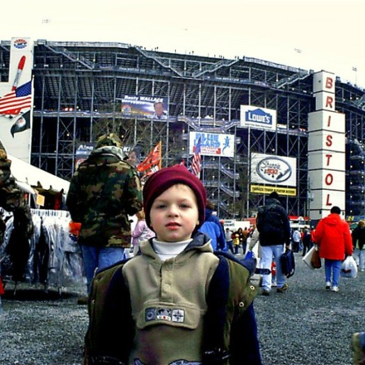 Aiden in front of Bristol Motor Speedway NASCAR Acceleration Nation