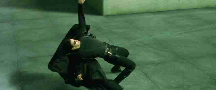 Neo from the Matrix dodging bullets