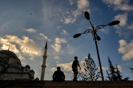 Two young men are seen in the vicinity of the Fatih mosque, named after Fatih Mehmed, the Ottoman sultan who conquered Constantinople in 1453. Istanbul, Turkey 2016. © Matteo Bastianelli
