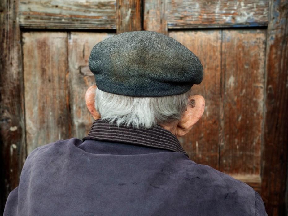 101-year-old Giulio Podda at his front door. San Sperate, Italy 2015. © Matteo Bastianelli