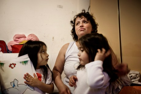 "An Argentinean woman with her two daughters who are some of the occupants at ""Casale de Merode"". Many people coming from different ethnic backgrounds and nationalities live together in the squat in harmony. Rome, Italy 2009. © Matteo Bastianelli"