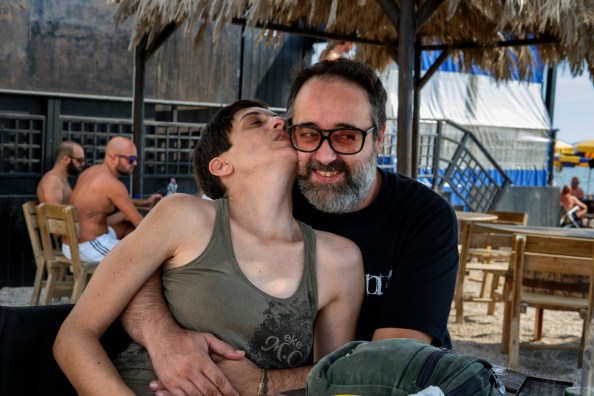 """Lucia Spiri, affected by multiple sclerosis and president of the first Italian cannabis social club, """"LapianTiamo"""", is seen in the arms of her husband William Verardi. Torre San Giovanni (Lecce), Italy 2016. © Matteo Bastianelli"""