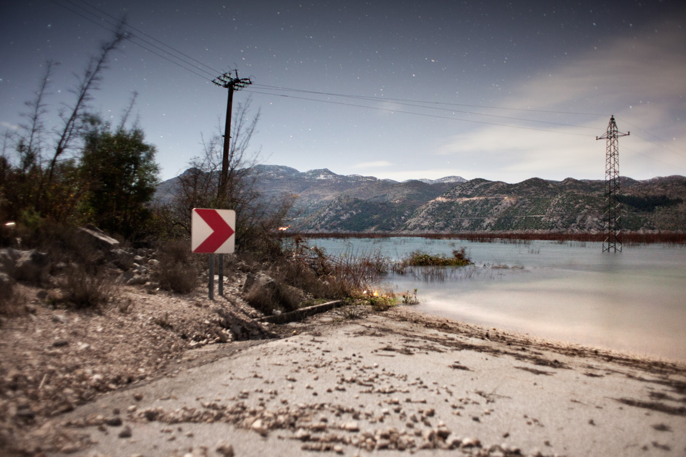 """Country roads and crops completely flooded. Pylons stand in the middle of the """"new lake"""" born just 20 days ago. Ravno, Bosnia and Herzegovina 2010. © Matteo Bastianelli"""