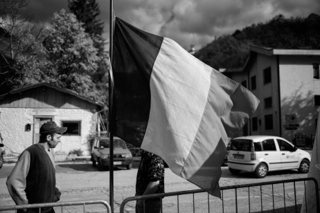 "Two young men are seen next to an Italian flag. Ussita, Italy 2016. © Matteo Bastianelli for ""La Stampa"""