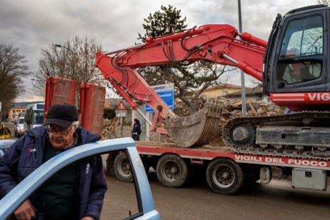 """A backhoe used by firefighters to demolish buildings badly damaged by the earthquake in the historical center. Amatrice, Italy 2016. © Matteo Bastianelli for """"La Stampa"""""""