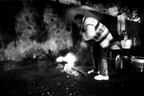 Patrizia builds a fire to keep warm at night. Velletri, Italy 2010. © Matteo Bastianelli