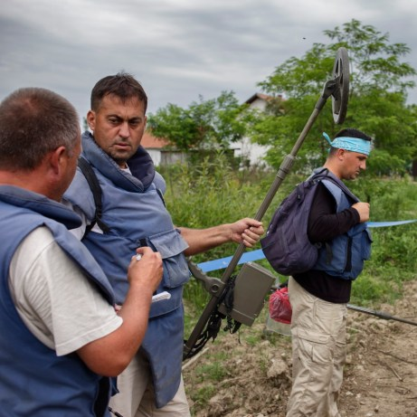Some Norwegian People's Aid deminers are seen outside a minefield after a day spent at work in Dubrave Community. Brčko District, Bosnia and Herzegovina, 2014.