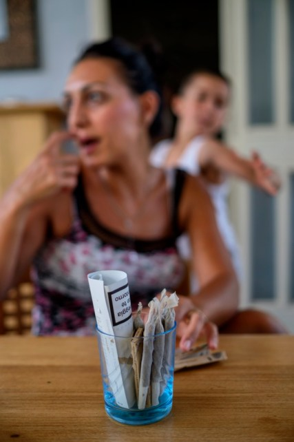 Some cigarettes of medical cannabis on a table, at 38-year-old Andrea Trisciuoglio's house. Affected by multiple sclerosis, his wife Anna rolls dozens of therapeutic cigarettes for her husband Andrea every day. Foggia, Italy 2016. © Matteo Bastianelli