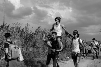 A group of Syrian asylum seekers arrived in Idomeni carrying one of their friends on their shoulders. He had been shot in the leg in Syria. Idomeni, Greece 2015. © Matteo Bastianelli