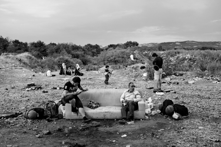 Some refugees are seen waiting to be allowed by the border police of North Macedonia to enter the country. Idomeni, Greece 2015. © Matteo Bastianelli