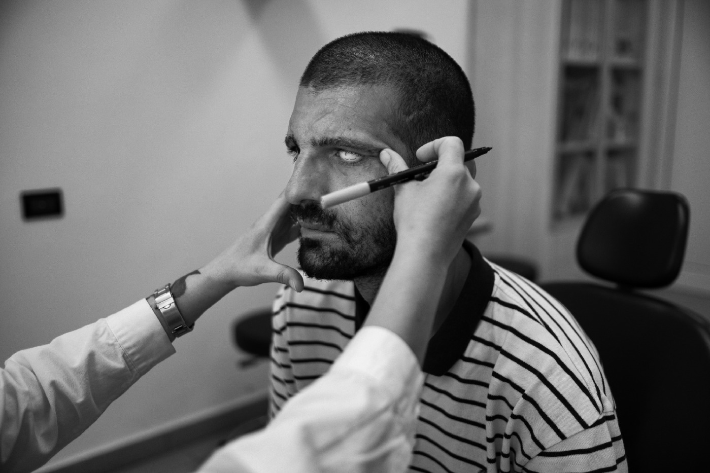 34-year-old Adis Smajic is being examined by the ophthalmologist, who measures the exact position of his iris in order to make his final prosthetic eye. Rome, Italy 2016. © Matteo Bastianelli