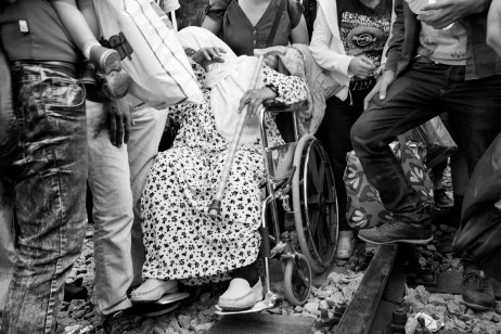 An old Syrian woman in a wheelchair burst out in tears when the border police of North Macedonia said they would not permit refugees to enter the country. Idomeni, Greece 2015. © Matteo Bastianelli