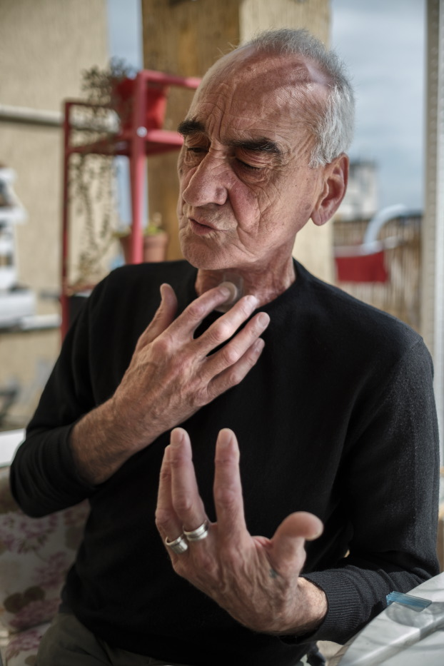 65-year-old Pierluigi Tomassini is seen in his house while speaking with the help of a tracheal prosthesis. He underwent several surgeries for throat and lung cancer, not being able to speak for eight years. Whilst having a medical prescription, he uses cannabis for therapeutic purposes coming from the black market not being able to afford medical cannabis from pharmacies. Rome, Italy 2017. © Matteo Bastianelli