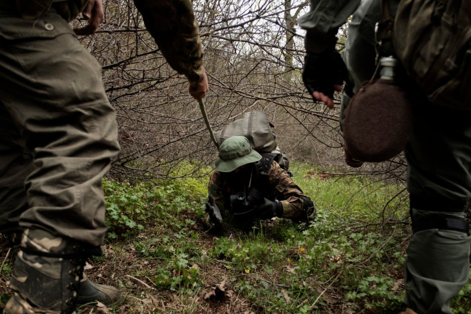 "A 31-year-old man originally from Burgas, is seen crawling under the brambles whilst patrolling the border. «I decided to join the ""Vasil Levski"" Bulgarian Military Veterans Union -he affirms- because our government doesn't want to protect us. Nobody will defend us, and therefore, we take it unto ourselves. This is a planned invasion. Those who illegally cross the border are soldiers, not just migrants». Yasna Polyana, Bulgaria 2017. © Matteo Bastianelli"