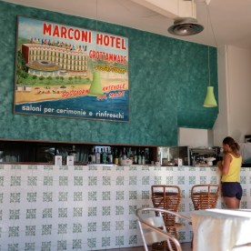 A young woman is seen by the bar of the Marconi hotel, used as an accommodation for about 90 evacuees coming from the town centers affected by the earthquake of 24 August 2016. Grottammare, Italy 2017. © Matteo Bastianelli
