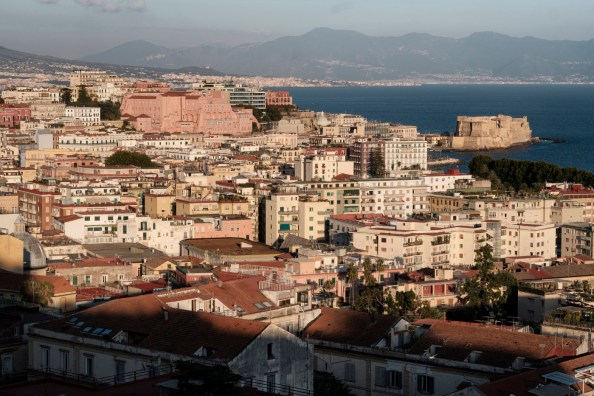"""A view of the Gulf of Naples, synonymous with flair and tailoring craftsmanship for centuries. In 1351 in the shadow of Vesuvius, the """"Confraternita dei Sartori"""" was established, right around the time that Naples was a point of reference for fashion and lifestyle, as much as London and Paris. Naples, Italy 2017. © Matteo Bastianelli"""