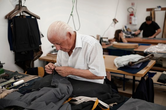 A tailor at work in the workshop of Sartoria Sabino, that since 1928 has been exporting handmade tailored suits all over the world. Casalnuovo, Naples, Italy 2017. © Matteo Bastianelli