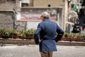 Mariano Rubinacci is seen in front of his atelier, located inside the historical building of Palazzo Cellammare, where suits for some of the finest men in Italy are made. Naples, Italy 2017. © Matteo Bastianelli
