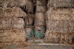 A bicycle between some hemp straw bales at the first hemp processing center in northern Italy. Carmagnola, Italy 2017. © Matteo Bastianelli
