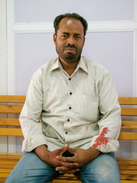 A man in tears in the trauma center. He arrived with his cousin in pain and bleeding heavily with complex lacerations on both legs and penetrating abdominal injuries. She received 4 bottles of blood transfusion and was transferred to an other hospital. Luckily she survived, but both of her legs were later amputated. Taiz, Yemen 2018. © Matteo Bastianelli