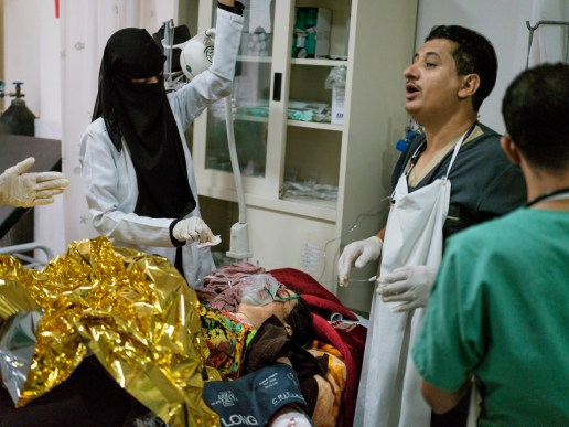 Doctors and nurses at the Mother and Child Hospital trauma center stabilize 25-year-old Imar Abdu Najei, whose legs were maimed in an explosion while she hung laundry. After receiving four blood transfusions, she was transferred to another hospital, where both of her legs were amputated. Taiz, Yemen 2018. © Matteo Bastianelli