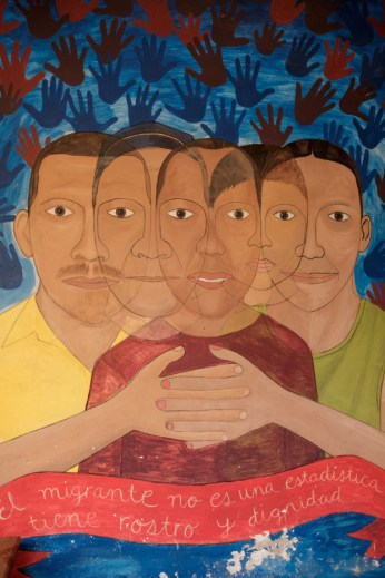 "A mural saying ""The migrant is not a statistic, he has a face and dignity"" painted in the shelter of ""Casa del Buen Samaritano"" by the migrants hosted in the facility with the help of volunteers from the Migrant Orientation Center of Oaxaca (COMI), a nonprofit organization that provides humanitarian assistance to migrants. Oaxaca de Juarez, Mexico 2019. © Matteo Bastianelli"
