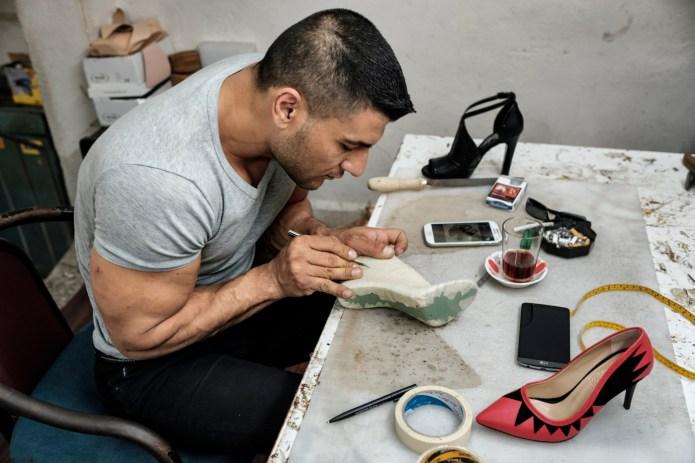 39-year-old award-winning Syrian bodybuilder, Ibrahim Shehabi, is seen busy designing a woman's shoe in the laboratory in a small artisan shop. Istanbul, Turkey 2016. © Matteo Bastianelli
