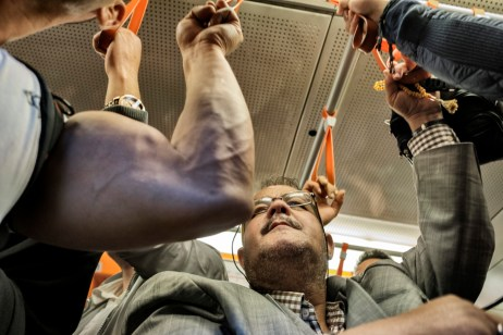 39-year-old award-winning Syrian bodybuilder, Ibrahim Shehabi, is seen in a busy subway. Ibrahim weighed about 100 kg when he was arrested by agents of Assad's regime, in January 2011, on charges of selling medicines without a license at his own gym; a trumped-up accusation, according to Ibrahim. At the time of his release in 2013, he only weighed about 60 kg. Istanbul, Turkey 2016. © Matteo Bastianelli
