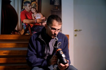 "Carlo Monaco, co-founder of the cultural association ""Canapa caffè"", is seen using a medical cannabis vaporizer for therapeutic inhalation in the Therapy Room. Rome, Italy 2016."