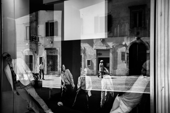 Fallen mannequins in the window of a store in the historic centre badly damaged by the earthquake. L'Aquila, Italy 2009. © Matteo Bastianelli
