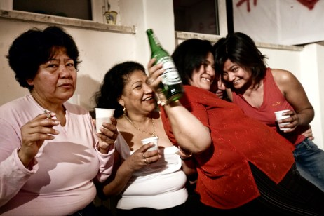 """A birthday party with South Americans and other residents from the squat at """"Casale de Merode"""". Many people coming from different ethnic backgrounds and nationalities live together in the squat in harmony. Rome, Italy 2009. © Matteo Bastianelli"""