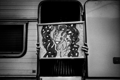Patrizia is seen in front of a caravan she received as a present from a friend. She had been living at the station since a couple of years ago when she got a council house. She still has the painting I made for her. Velletri, Italy 2011. © Matteo Bastianelli