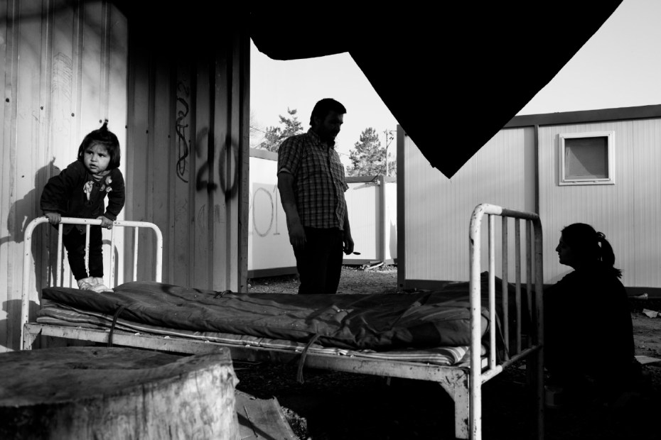 A Syrian family outside one of the containers in a former Bulgarian military base, turned into a refugee camp to meet the humanitarian emergency of asylum seekers fleeing the Syrian Civil War. Harmanli, Bulgaria 2014. © Matteo Bastianelli