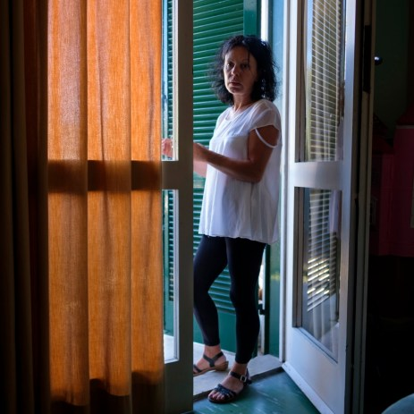 45-year-old Annunziatina Attenni is seen inside the hotel room where she has been staying with her daughter for about a week now. Grottammare, Italy 2017. © Matteo Bastianelli