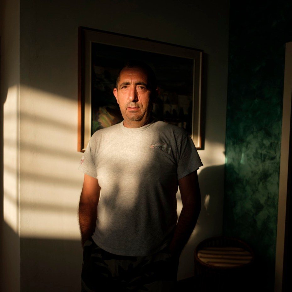 Gabriele Vittori portrayed inside the Marconi hotel where he has been temporarily staying with other victims of the earthquake of 24 August 2016. He goes to Accumoli everyday to work at his construction company. Grottammare, Italy 2017. © Matteo Bastianelli