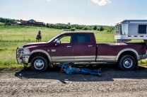 A rider relaxes in the shade of his pickup after competing in the bareback riding competition during the first day of the Wessington Springs Foothills Rodeo on Saturday, May 28 at the Jerauld County 4-H arena.