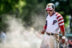 Parkston Mudcats' Jeff Harris (8) celebrates a run scored after sliding into home plate during a game against the Vermillion Grey Sox in the first round of the Class B state amateur baseball tournament on Thursday at Cadwell Park in Mitchell.