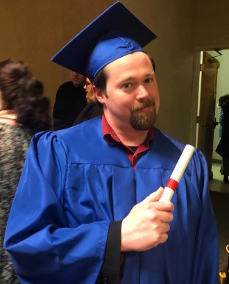 Matthew Bachman in his blue cap and gown at the 2019 McCann School of Business and Technology graduation ceremony.