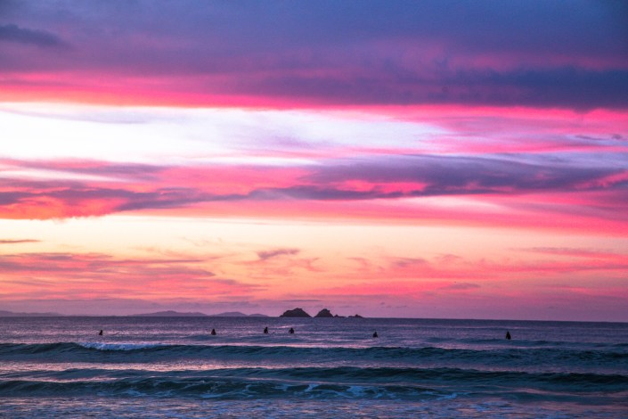 pink sunset over the ocean in byron bay australia